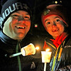 Father and son from Ayer, Kevin Williams with Alex Williams,6, light up candles before the first ever Candlelight Stroll in ndowntown Ayer. Nashoba Valley Voice Photo by David H. Brow.