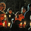 Locals with candles lit all set to head out on the first ever Candlelight Stroll in downton Ayer and ending at the town hall for a holiday tree lighting and photos opp with Santa and Mrs Claus. Nashoba Valley Voice Photo by David H. Brow.