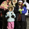 Family with friend are dressed for the cold as they start out on the very first Candlelight Stroll in downtown Ayer, L-R, front, Ava Tosi 5, her brother Nicolas Tosi 8, in back is Larry Tosi dad, and friend Debby Gavin from Pepperell, and Erin Tosi from Ayer. Nashoba Valley Voice Photo by David H. Brow.