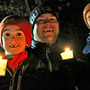 Candles lit and ready to head out on the first ever Candlelight Stroll in downtown Ayer is L-R, Alex Williams 6, Kevin Williams, dad, and Nick Williams 8, all from Ayer. Nashoba Valley Voice Photo by David H. Brow.
