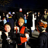 Young and old alike getting their candles lit for ther first ever Candlelight Stroll in downtown Ayer ending up at the town hall for a holiday tree lighting. Nashoba Valley Voice Photo by David H. Brow.