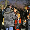 Local folks light up candles as they make ready to head out on the first ever Candlelight Stroll in downtown Ayer. Nashoba Valley Voice Photo by David H. Brow.