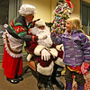 Little Ruby Willis, 6, of Ayer is happy to receive a candy cane from Mrs Claus and Santa after the Holiday Tree lighting and Candlelight Stroll at Ayer Town Hall. Nashoba Valley Voice Photo by David H. Brow.