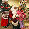Hazel Willis, 6, of Ayer, does a meet & greet with Mrs Claus and Santa after her twin sister Ruby did the same at Ayer Town Hall right after the Holiday Tree lighting. Nashoba Valley Voice Photo by David H. Brow.