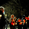 Giving a pep and info talk on the first ever Candlelight Stroll in downtown Ayer is , on far right, Alan S. Manoian, Ayer's Dir. of Community and Economic Development, before heading on on the stroll and ending at the town hall for a holiday tree lighting. Nashoba Valley Voice Photo by David H. Brow.