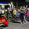 Large group of over 200 hundred folks head up Main Street in downtown Ayer as they follow Santa and Mrs Claus in the first Candlelight Stroll to Ayer Town Hall for a Holiday Tree lighting. Nashoba Valley Voice Photo by David H. Brow.
