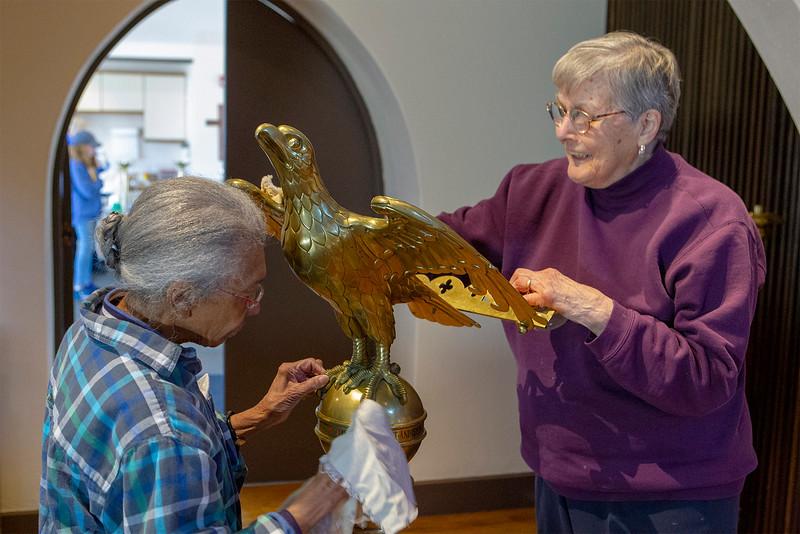 Barbara Kamb and Barbara Ledeaux cleaning up the eagle<br /> SENTNEL&ENTERPRISE/Scott LaPrade