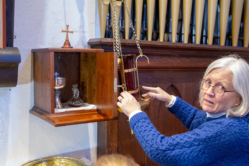 Isabel Geller Senior Warden of the Church shows where the vandels had broken in this ombre where it is locked that holds the sacraments-SENTINEL&ENTERPRISE/Scott LaPrade