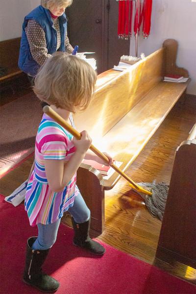 Mackenna Knowles mops the floor between the pews<br /> SENTNEL&ENTERPRISE/Scott LaPrade