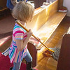Mackenna Knowles mops the floor between the pews<br /> SENTNEL&ENTERPRISE/Scott LaPrade