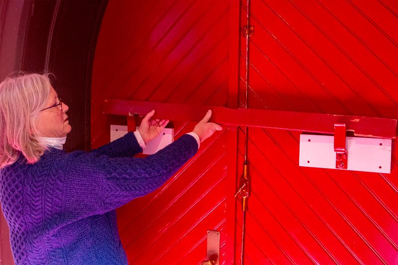 Isabel Geller Senior Warden of the Church shows the door that was broken into<br /> SENTINEL&ENTERPRISE/Scott LaPrade
