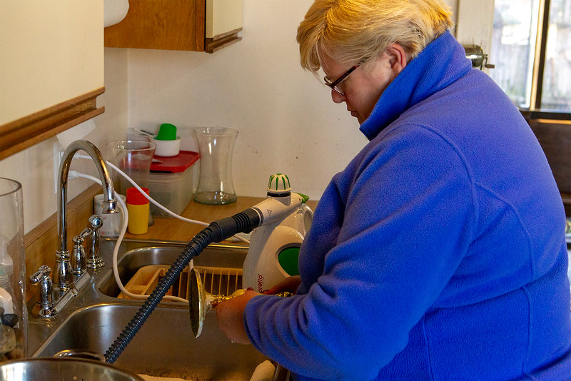 Charlotte Whatley steam cleans the candle holders <br /> SENTINEL&ENTERPRISE/Scott LaPrade