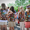 Girl Scouts with full vests of pacthes participate in the Memorial Day Parade in Ayer on Saturday. SUN/Caley McGuane