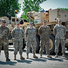 Soldiers stand in front of military trucks after the Memorial Day Parade in Ayer. SUN/Caley McGuane