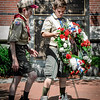 Boy Scouts Owen Salter and Gregory Kidder, both from Ayer, place a wreath near the memorial monuments after the Memorial Day Parade. SUN/Caley McGuane