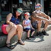From left, Patty Racca, her grandson Jackson Racca, 18 months, and Mike Racca, all from Ayer, enjoy the Memorial Day Parade from the sidewalk on Saturday with festive glasses. SUN/Caley McGuane
