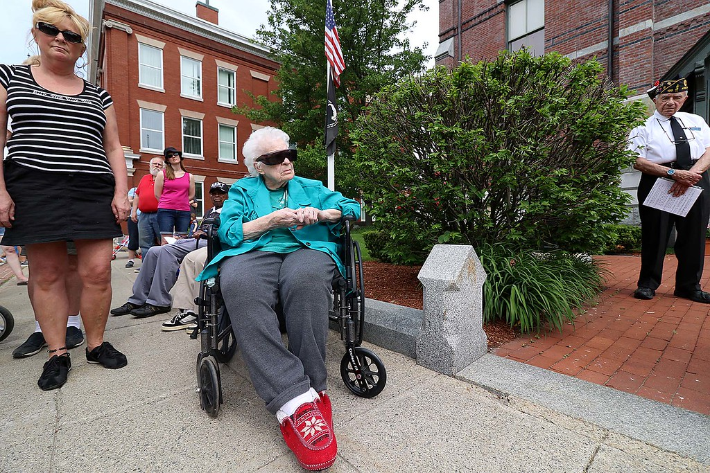 . The Town of Ayer held its Memorial Day parade and ceremony on Saturday May 26, 2018. The Parade went down Park Street to Main Street and stop for a ceremony at Town Hall. After that they went on to the Pirone Park where a wreath was thrown into Grove Pond. Eveylyn Carlson, 87, from Shirley listens to the speakers during the ceremony at town hall. SENTINEL & ENTERPRISE/JOHN LOVE