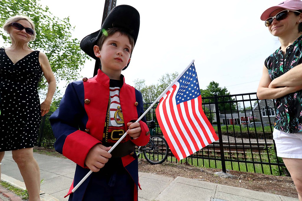 . The Town of Ayer held its Memorial Day parade and ceremony on Saturday May 26, 2018. The Parade went down Park Street to Main Street and stop for a ceremony at Town Hall. After that they went on to the Pirone Park where a wreath was thrown into Grove Pond. Dressed a patriot during the parade was Caleb Januskiewicz, 5. SENTINEL & ENTERPRISE/JOHN LOVE