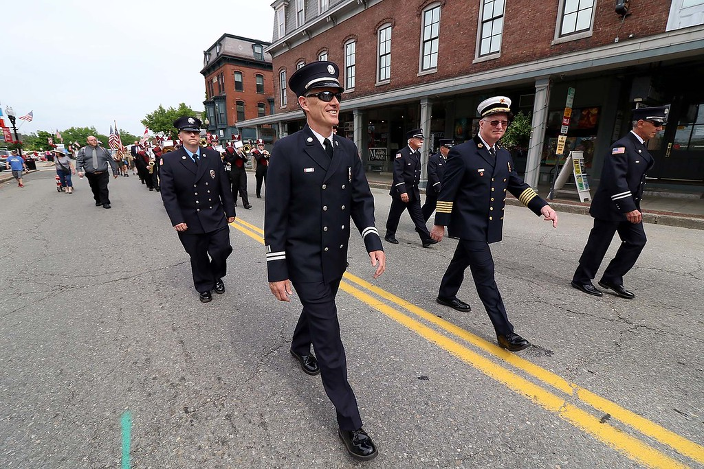 . The Town of Ayer held its Memorial Day parade and ceremony on Saturday May 26, 2018. The Parade went down Park Street to Main Street and stop for a ceremony at Town Hall. After that they went on to the Pirone Park where a wreath was thrown into Grove Pond. Members of the Ayer Fire Department make their way down Main Street during the parade. SENTINEL & ENTERPRISE/JOHN LOVE