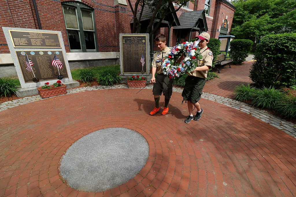 . The Town of Ayer held its Memorial Day parade and ceremony on Saturday May 26, 2018. The Parade went down Park Street to Main Street and stop for a ceremony at Town Hall. After that they went on to the Pirone Park where a wreath was thrown into Grove Pond. Boy Scouts Graham Wall from Troop 3 and Jamie Carney from Troop 2 place a wreath at the monuments at Town Hall. SENTINEL & ENTERPRISE/JOHN LOVE