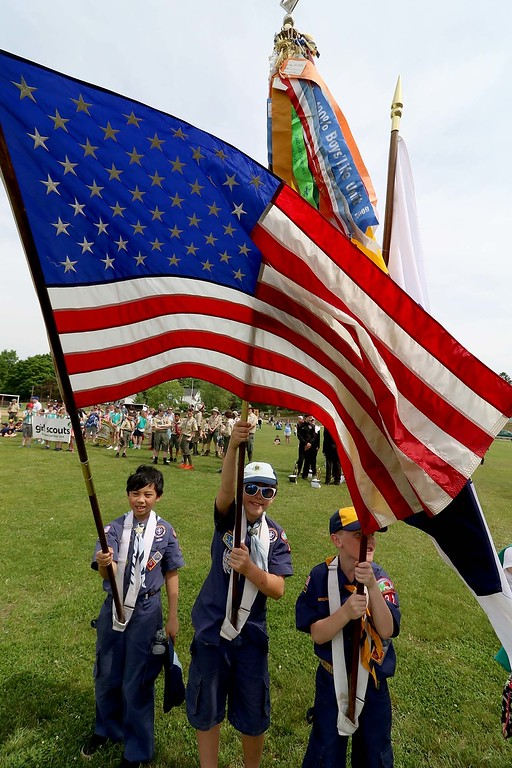 . The Town of Ayer held its Memorial Day parade and ceremony on Saturday May 26, 2018. The Parade went down Park Street to Main Street and stop for a ceremony at Town Hall. After that they went on to the Pirone Park where a wreath was thrown into Grove Pond. Some Cub Scouts hold flags at Pirone Park as the wreath was thrown into the pond.  SENTINEL & ENTERPRISE/JOHN LOVE