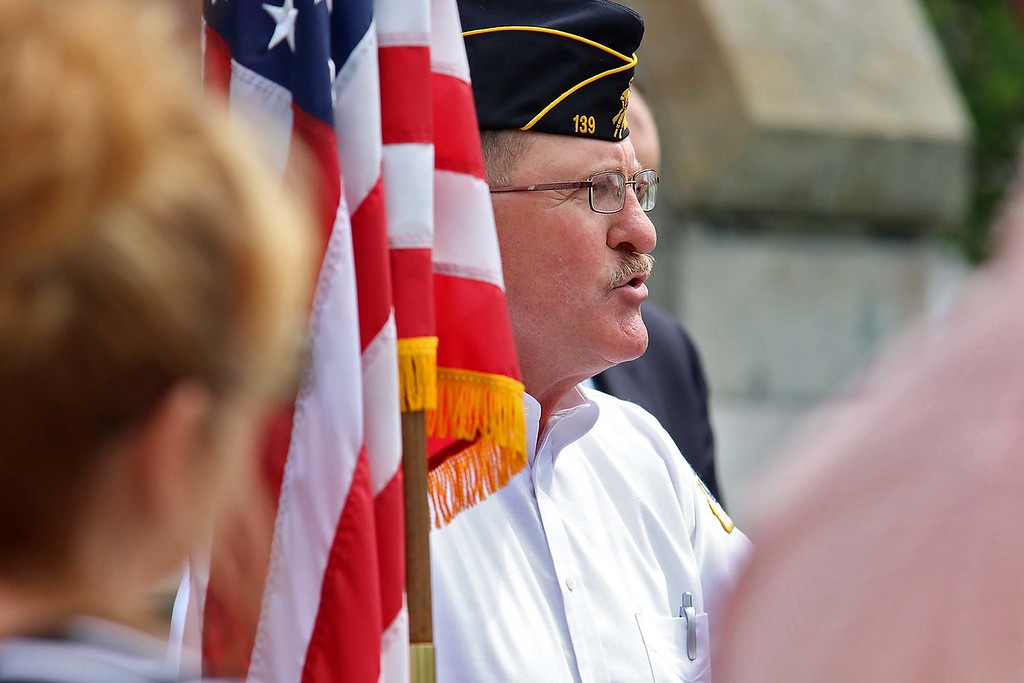 . The Town of Ayer held its Memorial Day parade and ceremony on Saturday May 26, 2018. The Parade went down Park Street to Main Street and stop for a ceremony at Town Hall. After that they went on to the Pirone Park where a wreath was thrown into Grove Pond. Guest speaker retired US Coast Guard Claude Poirier addresses the crowd at the ceremony held at town hall. SENTINEL & ENTERPRISE/JOHN LOVE