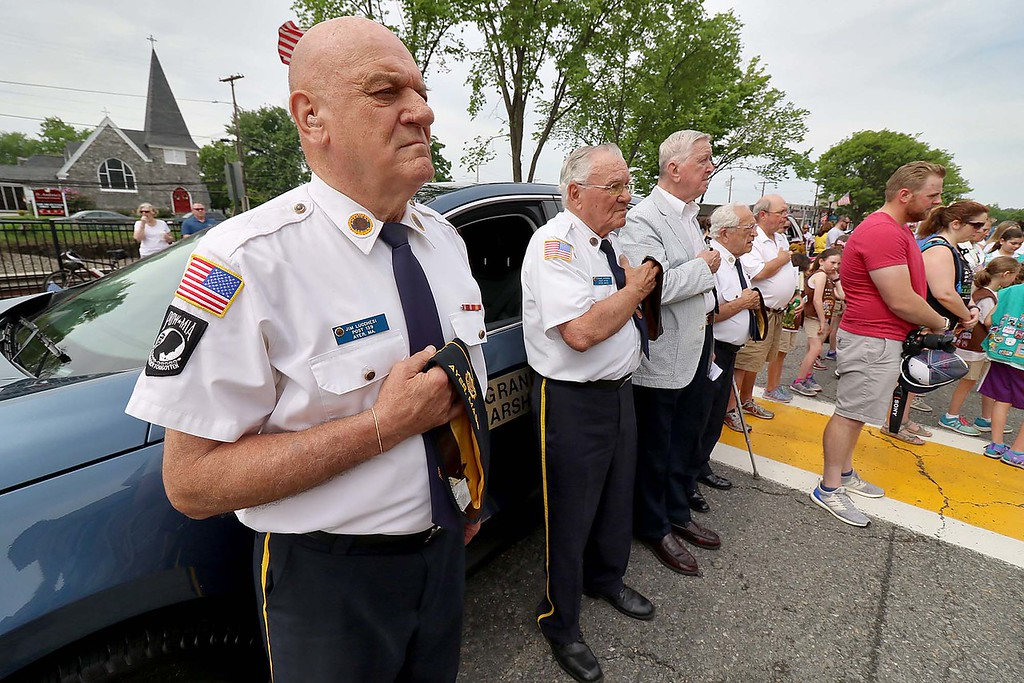 . The Town of Ayer held its Memorial Day parade and ceremony on Saturday May 26, 2018. The Parade went down Park Street to Main Street and stop for a ceremony at Town Hall. After that they went on to the Pirone Park where a wreath was thrown into Grove Pond. Ayer American Legion Post 139 member Jim Lucchesi, on left, stand with other members during the Pledge of Allegiance during the ceremony at town hall. SENTINEL & ENTERPRISE/JOHN LOVE