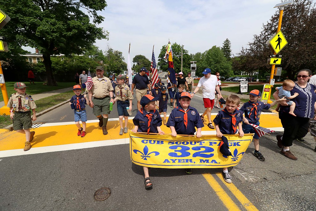 . The Town of Ayer held its Memorial Day parade and ceremony on Saturday May 26, 2018. The Parade went down Park Street to Main Street and stop for a ceremony at Town Hall. After that they went on to the Pirone Park where a wreath was thrown into Grove Pond. Ayer Cub Scout Park 32 make their way to Pirone Park as they walk Main Street in the parade. SENTINEL & ENTERPRISE/JOHN LOVE