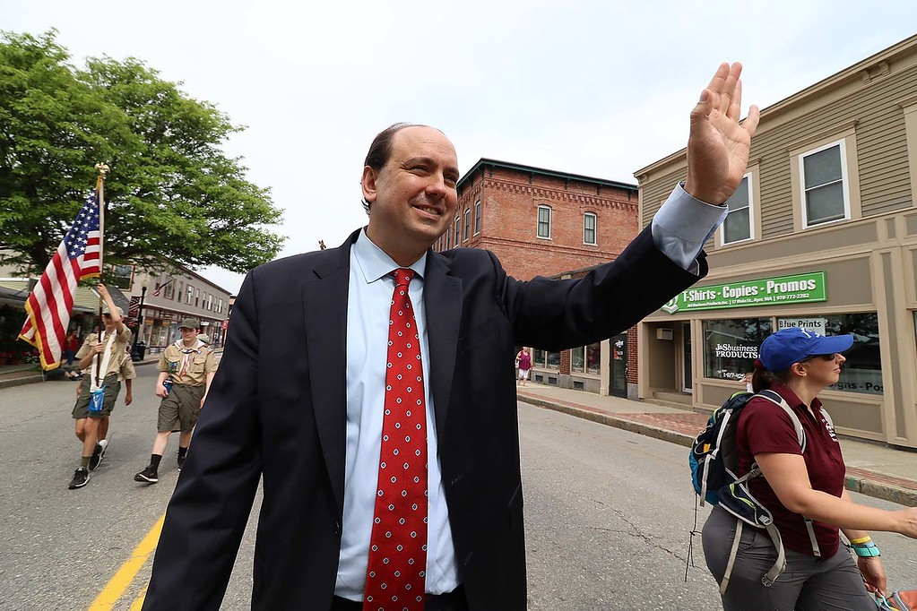 . The Town of Ayer held its Memorial Day parade and ceremony on Saturday May 26, 2018. The Parade went down Park Street to Main Street and stop for a ceremony at Town Hall. After that they went on to the Pirone Park where a wreath was thrown into Grove Pond. State Senator Jamie Eldridge waves to people watching the parade as he made his way down main Street during the parade. SENTINEL & ENTERPRISE/JOHN LOVE