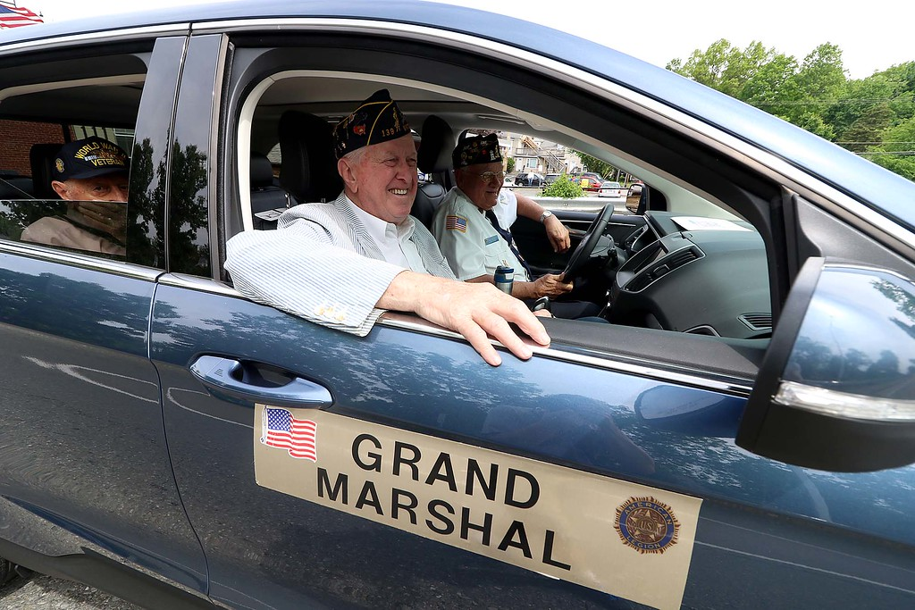 . The Town of Ayer held its Memorial Day parade and ceremony on Saturday May 26, 2018. The Parade went down Park Street to Main Street and stop for a ceremony at Town Hall. After that they went on to the Pirone Park where a wreath was thrown into Grove Pond. The parade Grand Marshal Donald Wallace rides in the parade. SENTINEL & ENTERPRISE/JOHN LOVE