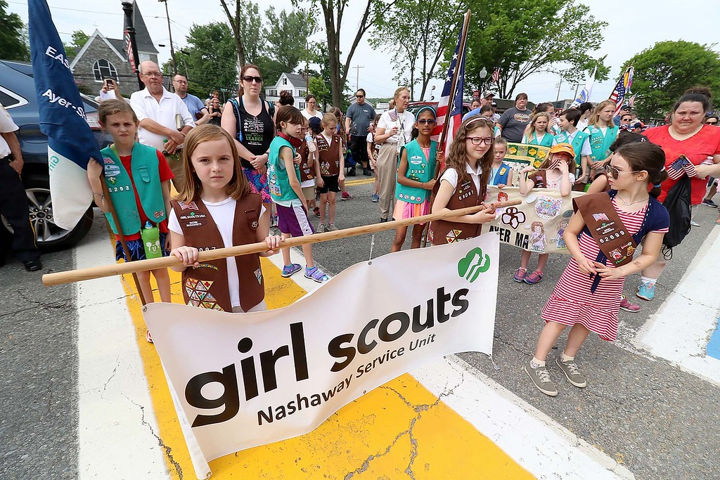 . The Town of Ayer held its Memorial Day parade and ceremony on Saturday May 26, 2018. The Parade went down Park Street to Main Street and stop for a ceremony at Town Hall. After that they went on to the Pirone Park where a wreath was thrown into Grove Pond. Girls scouts stand on main street as they listen to the ceremony at Town hall. SENTINEL & ENTERPRISE/JOHN LOVE