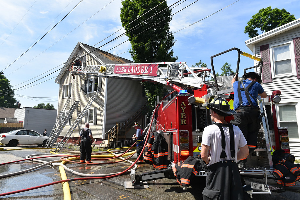 . Firefighters from surrounding town\'s assist with a structure fire on 10 East Main St. in Ayer on Sunday.  SENTINEL & ENTERPRISE JEFF PORTER