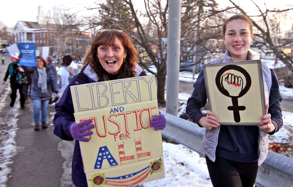 . Marching in the Women\'s March in Ayer are grandmother and grandaughter, L-R, Cindy Howes, 60, of Shirley, and Emily Russell,15 of Ayer. SUN/David H. Brow