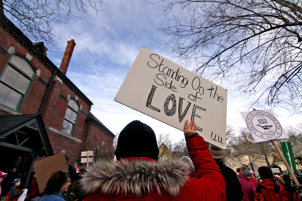 . Supporters of the National Women\'s March at a rally and march carry signs displaying their feelings at this Women\'s March in Ayer. SUN/David H. Brow