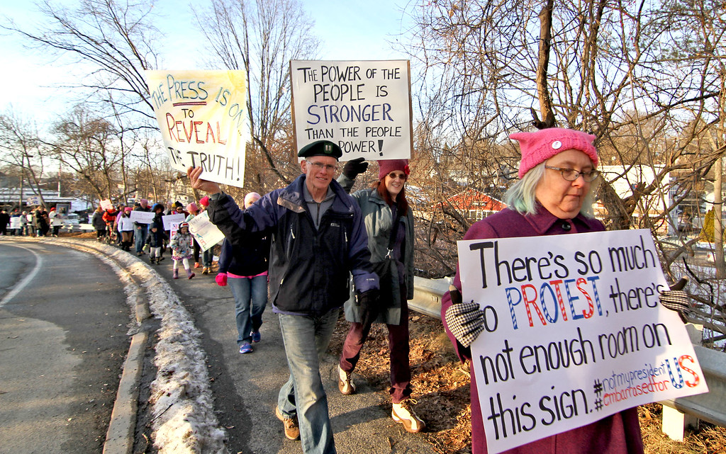 . People marching and carring signs in this local verison of the National Women\'s March, in Ayer, across the country. SUN/David H. Brow