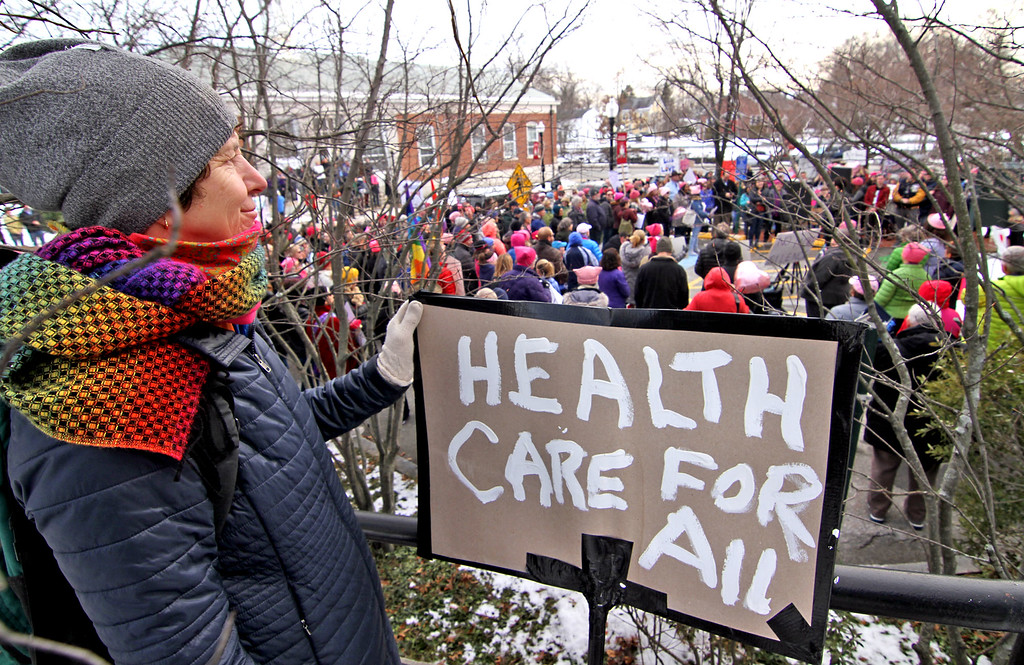 . Here at the local version of the National Women\'s March is Stephaine White Stanton of Lancaster, Ma, with a nice overview of the event next to the Ayer Town Hall. SUN/David H. Brow