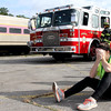Mock train crash victim, Nicole Patterson,22 of Littleton reacts as firefighters arrive at the scene in the PanAm railroad yard in Ayer. Nashoba Valley Voice Photo by David H. Brow