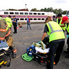 Area ER personal treat mock train crash victims at the PanAm railroad yard in Ayer. Nashoba Valley Voice Photo by David H. Brow