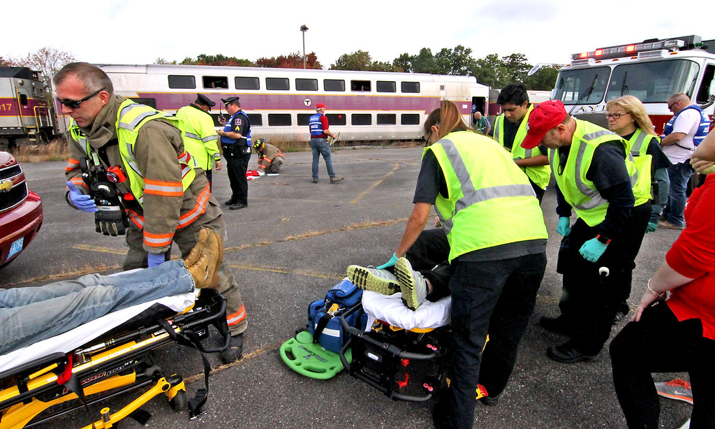 . Area ER personal treat mock train crash victims at the PanAm railroad yard in Ayer. Nashoba Valley Voice Photo by David H. Brow