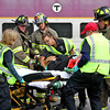 Littleton Firefighters and Harvard EMT's load a mock train crash victim onto a gurney. Nashoba Valley Voice Photo by David H. Brow