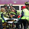 Littleton Firefighters and Harvard EMT's load a mock train crash victim onto a gurney. Nashoba Valley Voice Photo by David H. Brow