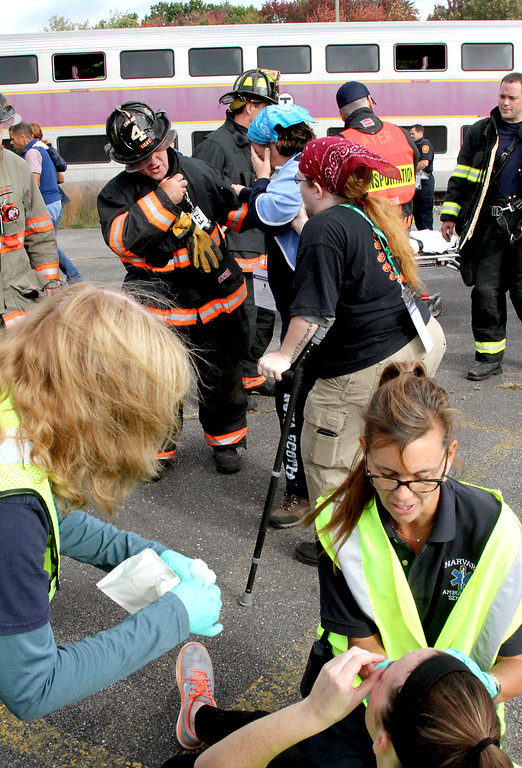 . Firefighters and EMT\'s process and treat mock train crash victims at the PanAm railroad yard in Ayer. Nashoba Valley Voice Photo by David H. Brow
