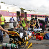 ER personal treat victims of a mock train crash at the PanAm railroad yard in Ayer. Nashoba Valley Voice Photo by David H. Brow
