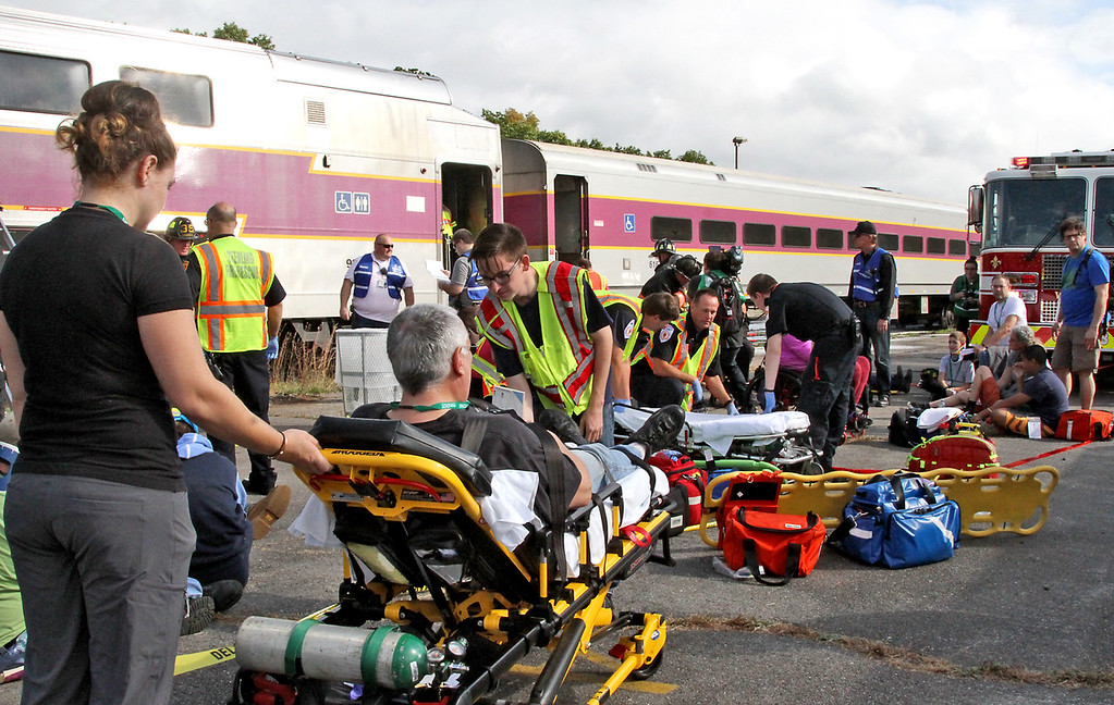 . ER personal treat victims of a mock train crash at the PanAm railroad yard in Ayer. Nashoba Valley Voice Photo by David H. Brow