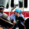 Mock train crash victims yell for help as they are led from the train by an conductor. Nashoba Valley Voice Photo by David H. Brow