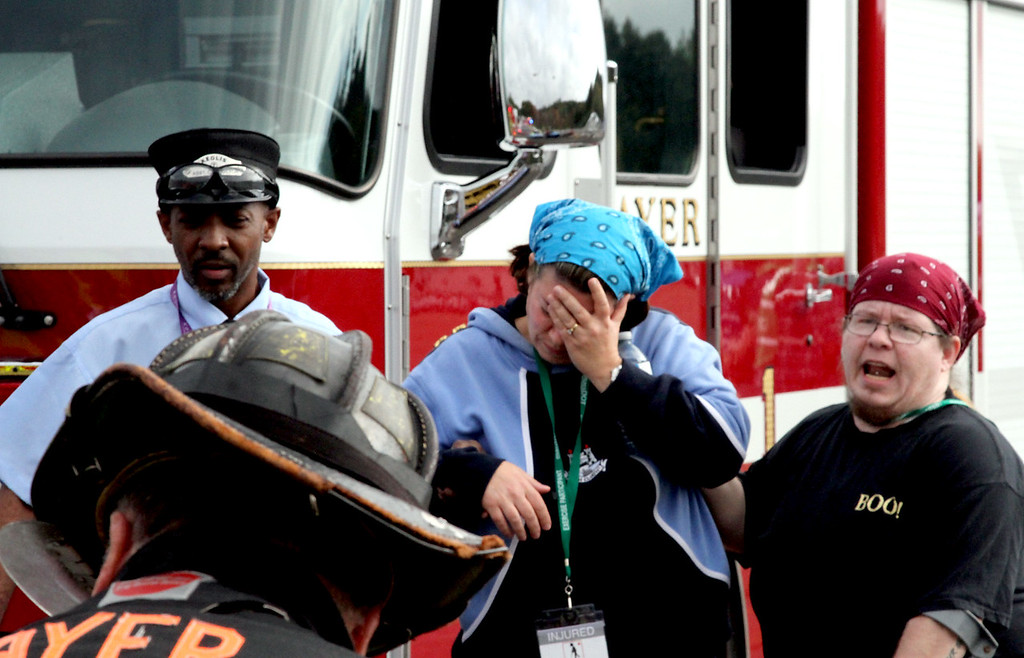 . Mock train crash victims yell for help as they are led from the train by an conductor. Nashoba Valley Voice Photo by David H. Brow