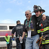 Ayer FF helps a mock train crash victim away from the scene of the mock crash in Ayer. Nashoba Valley Voice Photo by David H. Brow