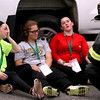 Mock train crash victims L-R, Nicole Patterson,22, Meaghann Ackerman,20 and her sister Ashley Ackerman,23, all from Littleton, speak with a Ayer FF to relay their injuries. Nashoba Valley Voice Photo by David H. Brow