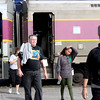 Victims exit a commuter train after a mock crash in the PanAm railroad yard in Ayer. Nashoba Valley Voice Photo by David H. Brow