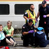 Firefighters and EMT's deal with mock train crash victims at the PanAm railroad yard in Ayer. Nashoba Valley Voice Photo by David H. Brow
